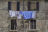Laundry-Day in Montepulciano (Runemaker) Tags: montepulciano tuscany italy laundry clothes clothesline windows architecture hilltown old wall shutters