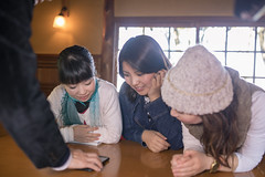 Female friends looking at screen on smart phone together (Apricot Cafe) Tags: img28768 asia asianandindianethnicities cafe japan japaneseethnicity kyotocity kyotoprefecture senioradult sigma35mmf14dghsmart casualclothing charming cheerful concentration day enjoyment fourpeople freedom friendship groupofpeople happiness indoors lifestyles lookingatscreen men midadult morning photography relaxation restaurant sitting smartphone smiling springtime sunlight surprise table teenager togetherness tourist traveldestinations waistup weekendactivities women youngadult kyōtoshi kyōtofu jp