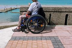 One Wheel (Ktoine) Tags: disabled candid street envy hope granville normandy handicaped handicap wheelchair beach tatoo tatooes composition