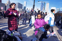 A Moment of Life of a Modern Protesting Family at Play (kirstiecat) Tags: children kids families parents girlscandoanything daca dreamers savedaca makefeminismintersectional street chicago canon protest liberal progressive women womensmarch womensrights humanrights thisiswhatdemocracylookslike thepeopleunitedwillneverbedefeated thepeopleunitedwillneverbedivided resist resistfascism impeachtrump trumpmustgo notrumpnokkknoracistusa people protestors signs plannedparenthood mycountrymyvoice nohumanisillegal iamawomanhearmeresist dissentingispatriotic america illinois shadows skyscrapers downtown skyline