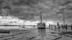 Untitled_PanoramaBW2 (kevinforrister) Tags: heybridge basin moody river blackwater mud light beach clouds rowing boat mast essex jetty
