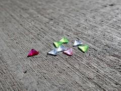 Four Colours (Robert Cowlishaw (Mertonian)) Tags: canonpowershotg1xmarkiii robertcowlishaw mertonian backyardphotolab bypl random plastic triangles markiii g1x please canon fourcolours macro open concretecanvas cement concrete texture spaces colors colours ordinary