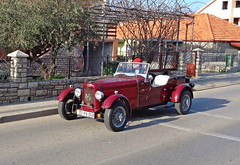 Driving an old-style car (Elvis L.) Tags: oldtimer replica car automobile ngcars ngta oldstyle zadar dalmatia croatia road driver driving street kitcar