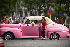 Bastante en Rosa (Poocher7) Tags: prettyinpink bastanteenrosa car pink pinkcar cuba havana square palmtrees streetphotography sunglasses people driver prettygirl cigarette smoking redtop blackjeans trafficsign convertible softtop sundaylights