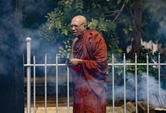 A Monk With Incense Offerings At Sri Mahabodhi Temple, Anuradhapura, Sri Lanka (El-Branden Brazil) Tags: srilanka sacred kandy buddhism buddhist offerings asia asian southasia monk robes incense street
