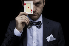 Me in suit with playing cards (Sandronn) Tags: background black bowtie blackbackground card hand luck poker gambling success casino game ace risk male people chance business caucasian play man leisure bet concept gamble winner suit gambler holding player adult young fun addiction win entertainment businessman lucky portrait heart person fortune stack standing human money showing table vegas