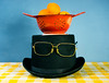 Top hat (*Jilltoo) Tags: utata:project=ip259 hat colander glasses red blue yellow tophat apricots stilllife matisse silly
