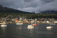 Ushuaia, late evening light (blauepics) Tags: argentina argentinien fireland feuerland tierra de fuego landscape landschaft ushuaia mountains berge snow schnee valley tal clouds wolken water wasser beagle channel kanal city stadt houses häuser coast küste shore ufer boats boote ships schiffe yacht abendlicht evening light jacht