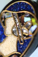 Art Deco Paua Shell Earring (Greenstone Girl) Tags: less than an inch macromondaysflickr lessthananinch earring artdeco paua shell blue woman hat
