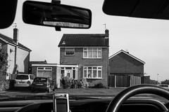 The Lawton's (Gary Kinsman) Tags: 2007 canonrebelxt canon1855mm barnton cheshire suburban architecture suburbs houses neovernacular housingestate elmwoodroad car window framed travel journey bw blackwhite
