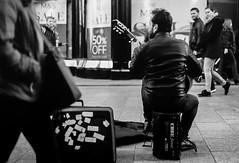 Grace Note (Mike Kniec) Tags: dublin street graftonstreet ireland grafton road guitar guitarist streetguitarist streetmusician irishmusician nikonfm2 nikon fm2 fm2n