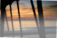 Sunrise through the Pilings (1 of 1) (mjdrhd) Tags: morning goldenhour seascape pier fog mist sunrise ocean outerbanks