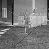 Clean Lines (35mm disjointed) Tags: topographic new mono urban garden flag stone grass gateshead washing line rotary clothes drier fence clean minimal night time after dark use shadow