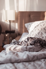 the unmade bed (thethomsn) Tags: bed bedroom indoors light geometric pattern tablelamp blanket messy pillow 6dii 50mm dof focus room sleep morning evening empty thethomsn unmadebed cozy