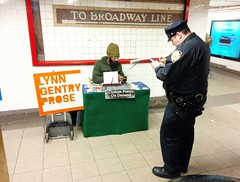 Are they preparing rhymes for an epic rap battle in the subway? (lucky_dog) Tags: police rap battle harassment quota ticket subway nyc new york city lynn gentry prose