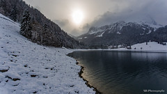 When the sun comes out (Silvan Bachmann) Tags: switzerland swiss suisse schweiz schwyz wägital lake water snow winter cold sun out clouds forest white atmosphere lakeshore nature landscape ray mountains colors drone dji phantom