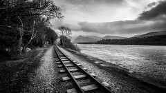 On track (Einir Wyn Leigh) Tags: landscape blackandwhite monochrome railway track drawing line mountains wales lake sky light black white walking winter january 2018 trees outside