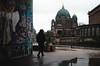 Berlin's Sides (kavierema) Tags: berlin urban classical berlinerdom graffiti redhat walking reflections shadows architechture people lights water red green