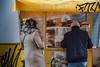 Bagel Man (nancy_rass) Tags: bagel greece athens stand market street seller pastry yellow urban