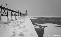 Covered Pier (mswan777) Tags: monochrome ansel 1855mm nikkor d5100 nikon white black cold winter coast shore seascape lakemichigan cloud rail water snow ice lighthouse pier