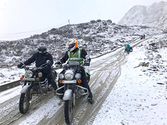 Riding on Ice (rajnishjaiswal) Tags: bike bikeride biking riding offroading ridingonice whitebackground mountain snowcoveredmountain snow beautifulnature tawang himalayas nature classic350 motorcycle