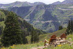 Bench with a view (Jeff Mitton) Tags: bench wildflowers landscape scenic wilderness mountains valley conifers peak ridge mountainside