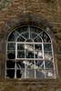 Broken Window (CEWWtyke) Tags: broken arch stone wall building architecture windowframe roof british aluminium smelting factory foyers decay lochness loch ness scottish highlands scotland uk black white blackandwhite bnw bw outdoor britain greatbritain window invernessshire fenetre