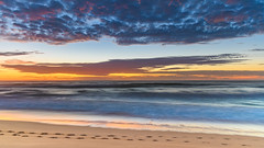 Sunrise Seascape with Footprints in the Sand (Merrillie) Tags: daybreak wamberalbeach sunrise cloudy australia surf centralcoast wamberal morning newsouthwales waves earlymorning nsw sea beach ocean nature landscape sky coastal waterscape outdoors seascape clouds coast water dawn