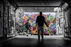 street portrait of a graffiti artist (Daz Smith) Tags: dazsmith fujixt20 fuji xt20 andwhite city streetphotography people candid portrait citylife thecity urban streets uk monochrome bristol bearpit gallery graffiti mural silhouette art