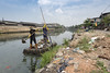 Cleaning Colombo (Photosightfaces) Tags: river men cleaning litter sri lanka srilanka srilankan raft pollution rubbish colombo environment canal