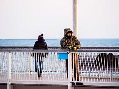 Winter Fisherman (deepaqua) Tags: brooklyn goldenhour offseason ocean winter coneyisland pier fishing bench atlanticocean fishingpole fisherman