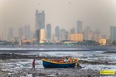 Mumbai Low Tide (Kostas Trovas) Tags: composition landscape nature people cityscape hajiali evening light instagram urban lowtide tide india outoors boat mumbai sky fog mist selectionfromindiatrip sea contrast