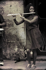Rhythm in the Streets (Poocher7) Tags: people portrait female musician flute fluteplayer dancing rhythm music streetphotography havana cuba prettywoman sandals dress bongos drummer doorway monochrome sepia retrolook músico debaile