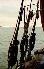 Colour on a calm day (David Ian Ross) Tags: kodak canon estuary monochrome 35mm voyage red sails port bow hemp canvas lead fore crew deadeyes staysail deck east smack shrouds tar boat water