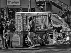 Doing Business (gecko47) Tags: stall souvenirs smallbusiness tourism bw santamonicapier california ocean pacificocean commerce