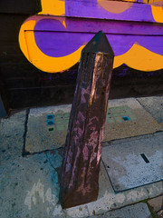 Twisted Metal (Steve Taylor (Photography)) Tags: art digital road graffiti mural streetart black yellow mauve purple metal uk gb england greatbritain unitedkingdom london texture cover bollard