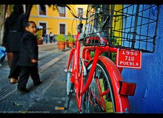 Light, Gesture and Color in Puebla, Mexico (Sam Antonio Photography) Tags: puebla mexico wheel bike bicycle transportation transport vintage wall cycle background old city retro building travel street yellow color colorful antique town road urban exterior lean classic concept against outdoors architecture handlebar samantoniophotography