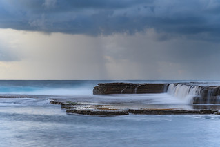 Overcast Sunrise Seascape with Cascading Water