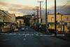 Sunrise on Keawe Street (wyojones) Tags: hawaii hilo bigisland keawest hi sunrise stores buildings streets tree clouds crosswalk stoplight powerpoles powerlines