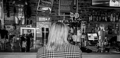 At the bar. . . (CWhatPhotos) Tags: cwhatphotos woman bar back bw portrait blondes blonde