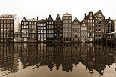 Old Amsterdam (Johan Konz) Tags: old amsterdam damrak netherlands city water reflections outdoor sepia canal cityscape house building