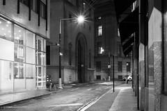 New York City | Hanover Street 01 (Christopher James Botham) Tags: nyc newyork newyorkcity manhattan street streetscape city cityscape urban fidi financialdistrict building architecture exchangeplace 20exchangeplace night lowlight mono outdoor rain rainy