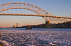 Sunset - Boat and Bridge on Ice (brucetopher) Tags: water ice sunset flow moving motion float floating winter cold arctic arcticblast weather freeze freezing frozen saltwater bay river canal stream current boat tug tugboat bridge light sunlight sunshine warmth