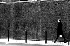 From a picket to the other one (pascalcolin1) Tags: paris13 homme man piquets pickets mur wall black noir chaussures shoes photoderue streetview urbanarte noiretblanc blackandwhite photopascalcolin canon50mm 50mm canon
