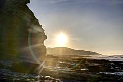 Circle the fringes (pauldunn52) Tags: sputherndown glamorgan heritage coast wale switches point rocks beach cliffs sea waves flare sun burst
