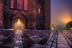 Roskilde Cathedral By Night (Jacob Surland) Tags: architecture building cathedral church city citybynight cityscape cobble country denmark door doorway geometry goldenlight hdr highdynamicrange light lights lines mist misty mood moody night path roskilde roskildecathedral roskildedomkirke spotlight time