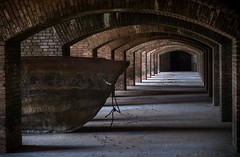 Boat in the Battery? (Matt Straite Photography) Tags: fort natonal park island key ocean bricks boat light tunnel brick dark historical history mudd gulf gulfofmexico perspective inside indoor old prison jail moat civil civilwar defense military army scaffolding