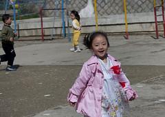 Young North Korean girl in Kwangbok school, Pyongan Province, Pyongyang, North Korea (Eric Lafforgue) Tags: asia asian boy boys child childhood children childrenonly communism day dictatorship dprk education elementaryage friendship girl girls happiness horizontal humanbeing joy kwangbokschool lookingatcamera nkorea6464 northkorea northkorean outdoors people primaryschool pupils pyongyang schoolchildren smile threepeople togetherness waistup youth pyonganprovince 北朝鮮 북한 朝鮮民主主義人民共和国 조선 coreadelnorte coréedunord coréiadonorte coreiadonorte 조선민주주의인민공화국 เกาหลีเหนือ קוריאההצפונית koreapółnocna koreautara kuzeykore nordkorea північнакорея севернакореја севернакорея severníkorea βόρειακορέα