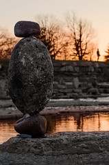 Two figures (LynxDaemon) Tags: rock sculpture ephemeral silhouette sunset equilibrium river trees ottawa canada
