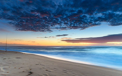 Sunrise Seascape with Fishing Rod (Merrillie) Tags: daybreak wamberalbeach sunrise cloudy australia surf centralcoast wamberal morning newsouthwales waves earlymorning nsw sea beach ocean nature landscape sky coastal waterscape outdoors seascape clouds coast water dawn